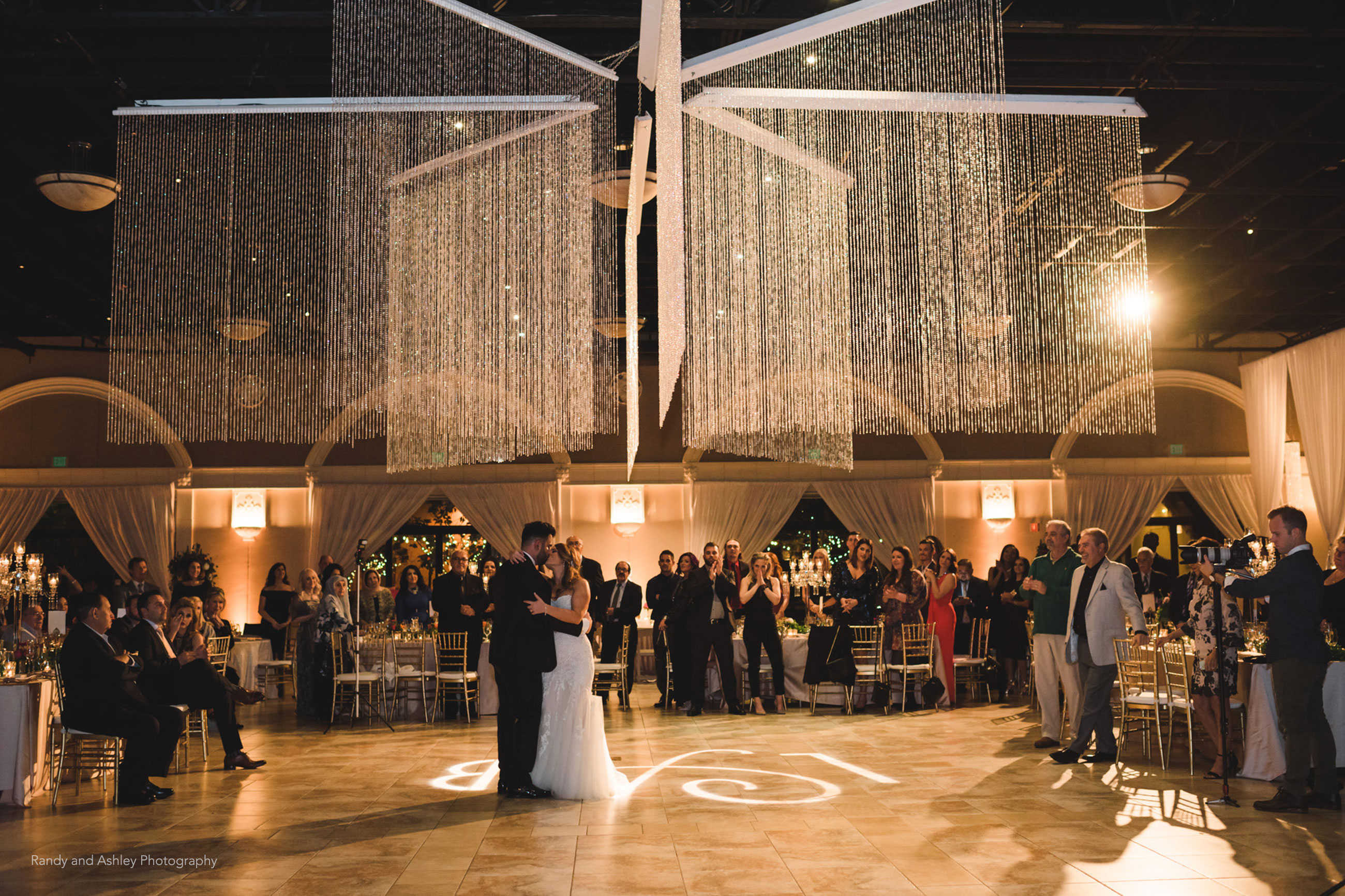 Beautiful first dance with overhead star chandelier during wedding reception at Casa Real at Ruby Hill Winery (www.casarealevents.com).  Photo by: Randy and Ashley Photography; Lighting: Fantasy Sound Event Services