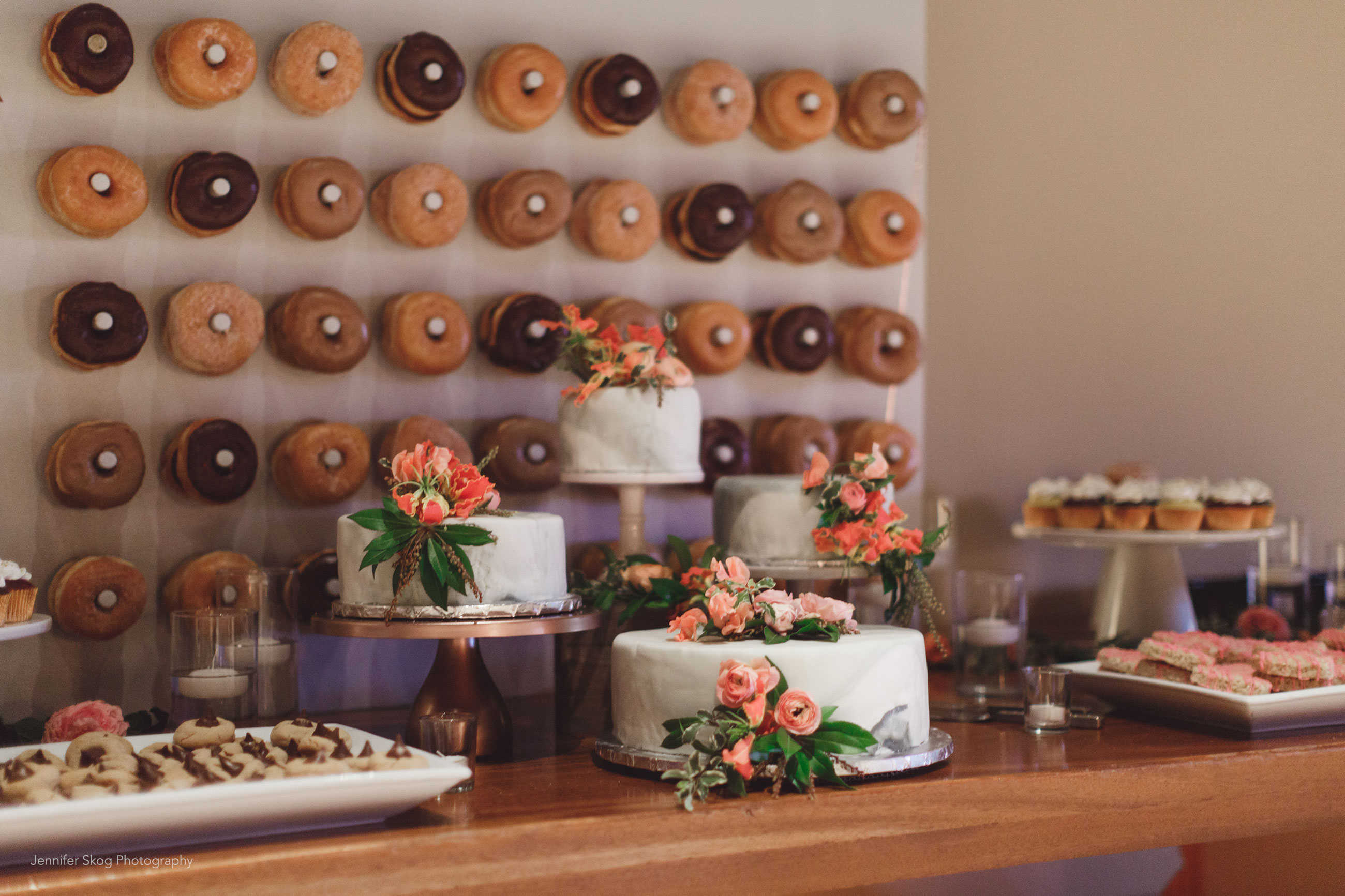 Wedding cakes, cupcakes and donut wall at Casa Real at Ruby Hill Winery (www.casarealevents.com).  Photo by: Jennifer Skog Photography; Cakes and Cupcakes: Cakes by Bev; Florals: Nicole Ha Design