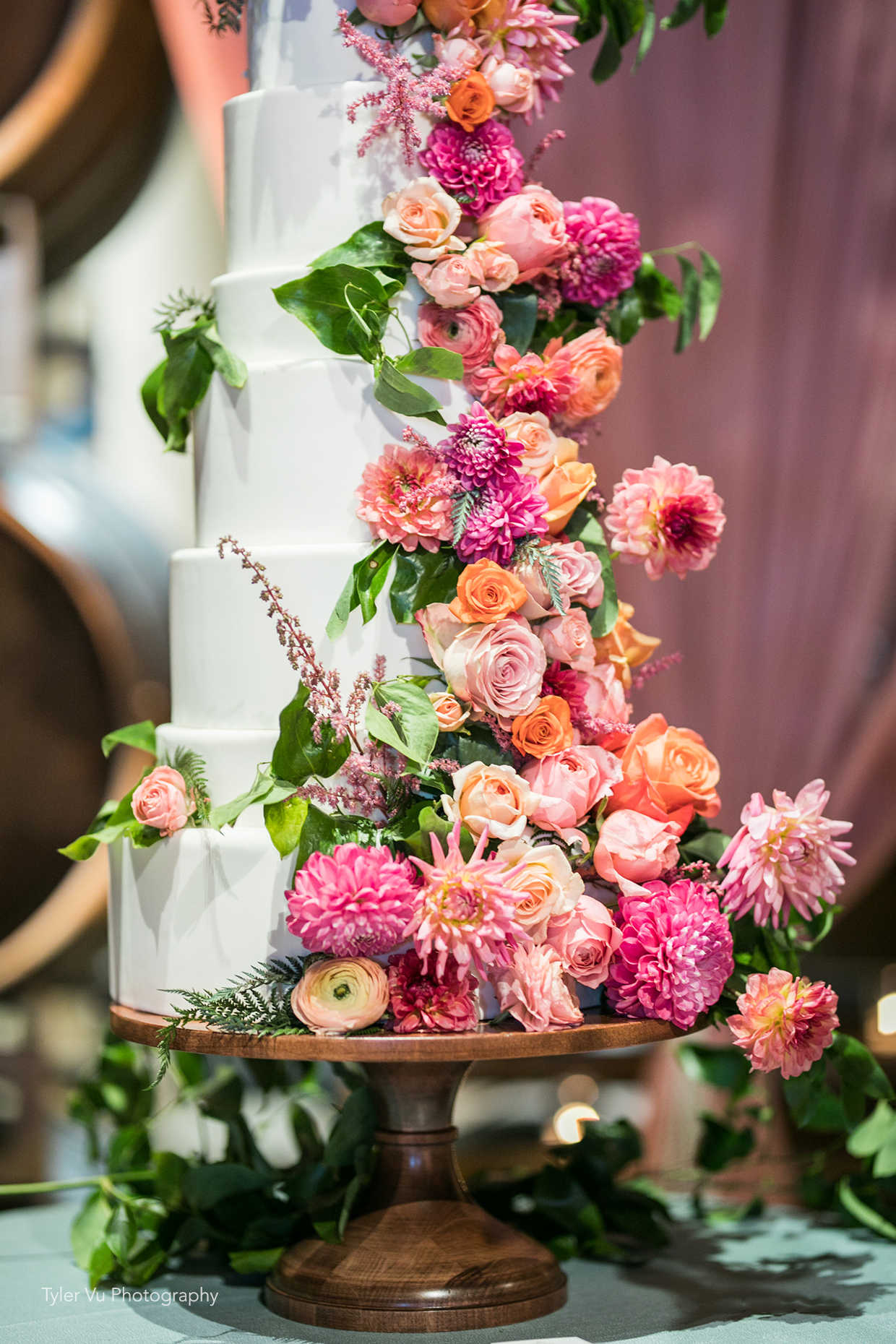 Beautiful dahlia and rose waterfall wedding cake at Casa Real at Ruby Hill Winery (www.casarealevents.com).  Photo by: Tyler Vu Photography; Florals: Enchantment Floral; Cake: Ma Petite Maison