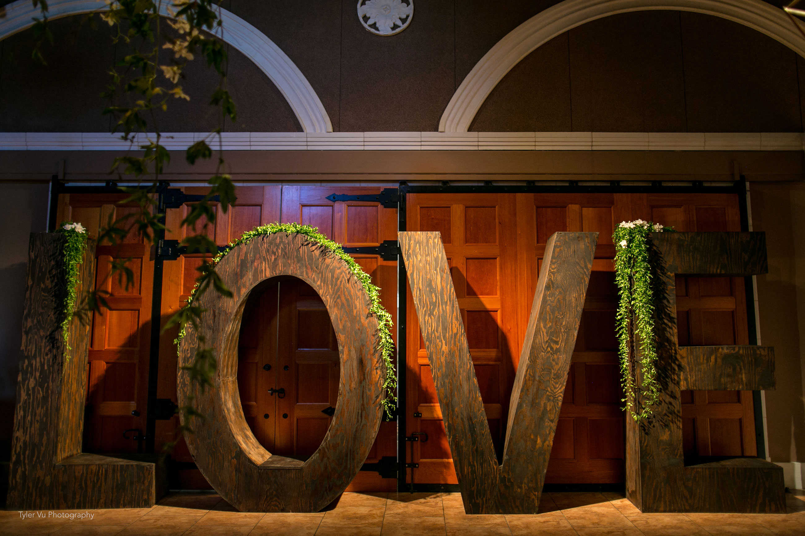 Rustic life-size LOVE letters at Casa Real at Ruby Hill Winery (www.casarealevents.com).  Photo by: Tyler Vu Photography.  Letters from Fantasy Sound Event Services